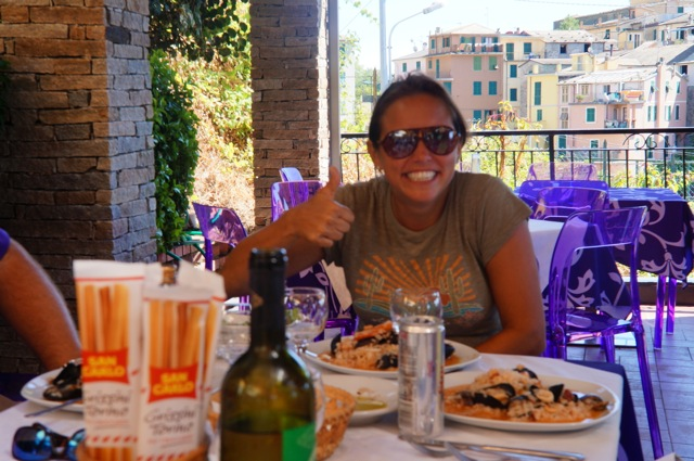 My friend Nicole enjoying seafood risotto in Cinque Terre